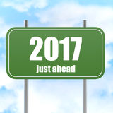 Street Sign With 2017 Just Ahead in Blue Sky. Image with hi-res rendered artwork that could be used for any graphic design Royalty Free Stock Photography