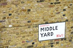 Street sign for Middle Yard Camden Royalty Free Stock Photography