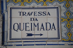 Street sign with mosaic tiles in Lisbon, Portugal Royalty Free Stock Image