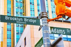 Street sign nameplate of Brooklyn Bridge and Adams Street and stock photography