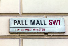 Street sign of Pall Mall in City of Westminster at Central London. Street sign of Pall Mall in City of Westminster on white plate at Central London. UK Stock Photos