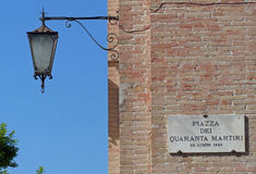 Street sign in the Piazza dei Quaranta Martiri, Gubbio. The piazza is dedicated to the memory of forty martyrs killed near here by the occupying German Nazi army Royalty Free Stock Photos