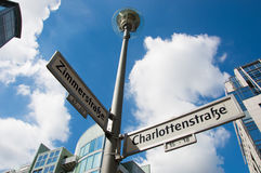 Street sign pointing to Zimmerstrasse and Charlottenstrasse Stock Images