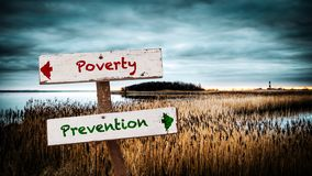 Street Sign Prevention versus Poverty. Street Sign the Direction Way to Prevention versus Poverty stock photography