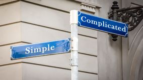 Street Sign Simple versus Complicated. Street Sign the Direction Way to Simple versus Complicated stock images