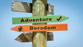 Street Sign to Adventure versus Boredom. Street Sign the Direction Way to Adventure versus Boredom stock photo