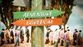 Street Sign to Adventure versus Boredom. Street Sign the Direction Way to Adventure versus Boredom stock image