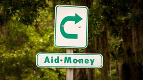 Street Sign to Aid Money. Street Sign the Direction Way to Aid Money stock photos
