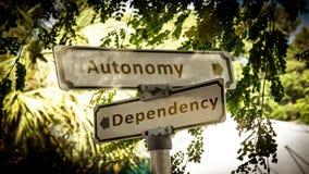 Street Sign to Autonomy versus Dependency. Street Sign the Direction Way to Autonomy versus Dependency royalty free stock photo