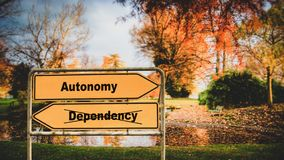 Street Sign to Autonomy versus Dependency. Street Sign the Direction Way to Autonomy versus Dependency royalty free stock images