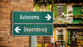 Street Sign Autonomy versus Dependency. Street Sign to Autonomy versus Dependency stock photos