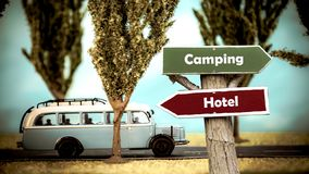 Street Sign to Camping versus Hotel. Street Sign the Direction Way to Camping versus Hotel stock photo