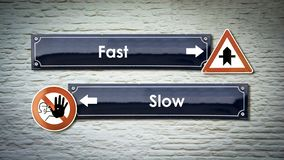 Street Sign to Fast versus Slow. Street Sign the Direction Way to Fast versus Slow royalty free stock photography