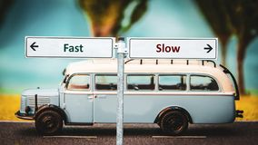 Street Sign to Fast versus Slow. Street Sign the Direction Way to Fast versus Slow stock image