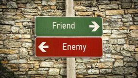 Street Sign to Friend versus Enemy. Street Sign the Direction Way to Friend versus Enemy stock images