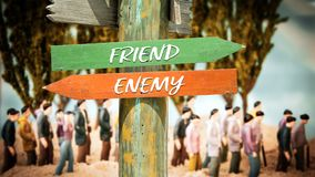 Street Sign to Friend versus Enemy. Street Sign the Direction Way to Friend versus Enemy royalty free stock photography