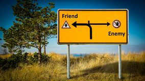 Street Sign to Friend versus Enemy. Street Sign the Direction Way to Friend versus Enemy royalty free stock images