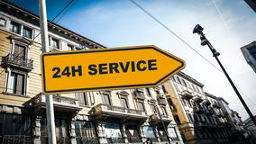 Street Sign to 24h Service. Street Sign the Direction Way to 24h Service royalty free stock photos