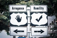 Street Sign to Humility versus Arrogance. Street Sign the Direction Way to Humility versus Arrogance stock photo