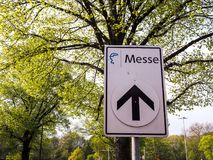 Street sign to the  Messe or international fair in Hannover, Ger Stock Images