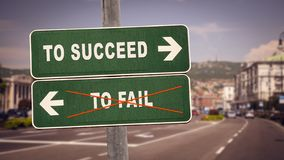 Street Sign TO SUCCEED versus TO FAIL. Street Sign the Direction Way TO SUCCEED versus TO FAIL royalty free stock photos