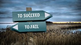 Street Sign TO SUCCEED versus TO FAIL. Street Sign the Direction Way TO SUCCEED versus TO FAIL stock images