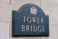 Street sign Tower Bridge on wall in City of London, England.