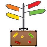 Street sign and travel suitcase. Tourism concept. Stock Image