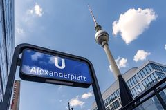 Street sign from U Bahn, Alexanderplatz in Berlin, taken from a low point of view. In the background the famous television tower a Stock Image