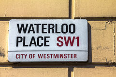 Street sign of Waterloo Place in City of Westminster at Central London, United Kingdom Stock Images