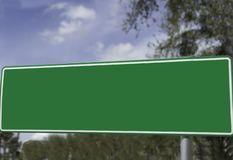 Street sign with with type removed for graphic purposes and design placement. Green Road placard which for graphic design purposes and indicates a street royalty free stock image