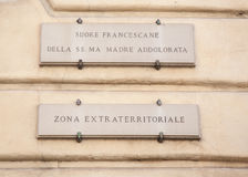 Street sign zona extraterritoriale in Vatican. Stock Photography
