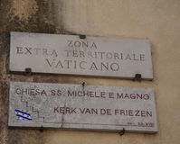 Street sign zona extraterritoriale in Vatican. Royalty Free Stock Images