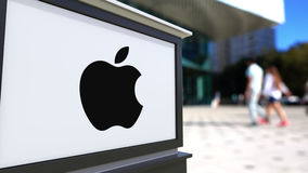 Street signage board with Apple Inc. logo. Blurred office center and walking people background. Editorial 3D rendering Royalty Free Stock Photography