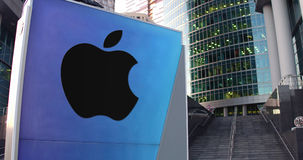 Street signage board with Apple Inc. logo. Modern office center skyscraper and stairs background. Editorial 3D rendering Stock Photo