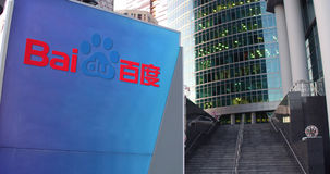 Street signage board with Baidu logo. Modern office center skyscraper and stairs background. Editorial 3D rendering Stock Photos