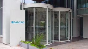 Street signage board with Barclays logo. Modern office building. Editorial 4K 3D rendering stock video footage