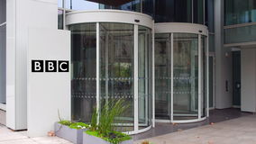 Street signage board with British Broadcasting Corporation BBC logo. Modern office building. Editorial 3D rendering Royalty Free Stock Image
