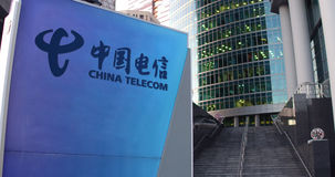 Street signage board with China Telecom logo. Modern office center skyscraper and stairs background. Editorial 3D Royalty Free Stock Photography