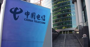 Street signage board with China Telecom logo. Modern office center skyscraper and stairs background. Editorial 4K 3D stock video footage