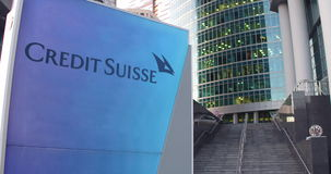 Street signage board with Credit Suisse Group logo. Modern office center skyscraper and stairs background. Editorial 3D Stock Photos