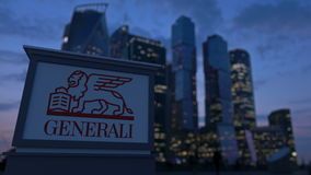 Street signage board with Generali Group logo in the evening.  Blurred business district skyscrapers backgroun Stock Photography
