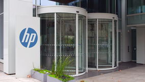 Street signage board with HP Inc. logo. Modern office building. Editorial 3D rendering Stock Photography