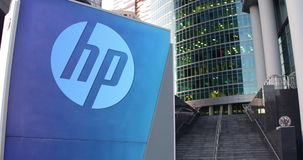 Street signage board with HP Inc. logo. Modern office center skyscraper and stairs background. Editorial 4K 3D rendering. ProRes stock video