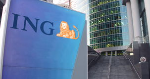 Street signage board with ING Group logo. Modern office center skyscraper and stairs background. Editorial 3D rendering Stock Photography
