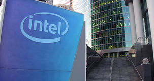 Street signage board with Intel Corporation logo. Modern office center skyscraper and stairs background. Editorial 3D Royalty Free Stock Photos