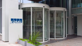 Street signage board with KPMG logo. Modern office building. Editorial 3D rendering Stock Images