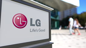 Street signage board with LG Corporation logo. Blurred office center and walking people background. Editorial 3D Royalty Free Stock Image