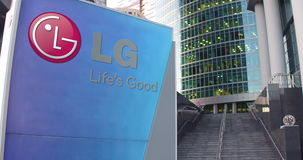 Street signage board with LG Corporation logo. Modern office center skyscraper and stairs background. Editorial 3D Stock Photography
