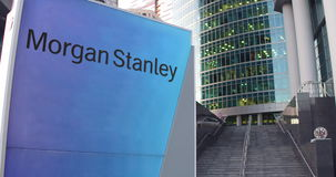 Street signage board with Morgan Stanley Inc. logo. Modern office center skyscraper and stairs background. Editorial 3D Royalty Free Stock Image